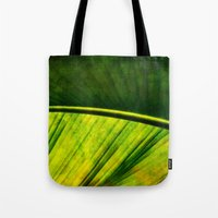 banana leaf Tote Bags featuring Banana leaf by helsch photography