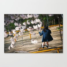 Swinging in the Sakura Canvas Print