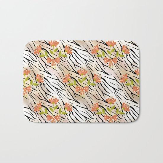 Floral pattern on a tiger background . Bath Mat