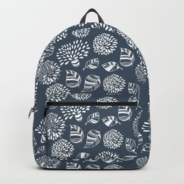 White doodle flowers and leaves on blue Backpack