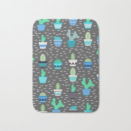 Potted cacti on a gray background Bath Mat