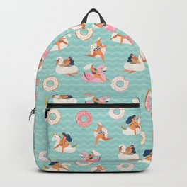 Gils on inflatable in swimming pool floats. Backpack