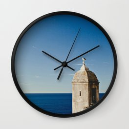Seagull sitting on an old stone tower, Monaco, Cote d'Azur Wall Clock
