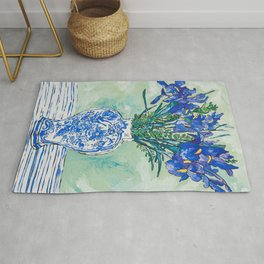 Iris Bouquet in Chinoiserie Vase on Blue and White Striped Tablecloth on Painterly Mint Green Rug