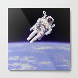 Astronaut Floating in Space Metal Print