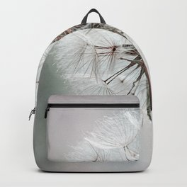 Delicate Dandelion Flower in soft light Backpack