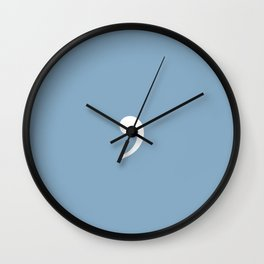 comma sign on placid blue color background Wall Clock
