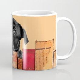Old Books and Black Pug dog behind Coffee Mug
