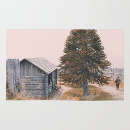 The cabin and the tree Rug