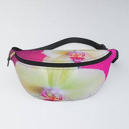 closeup white and pink orchids plant with pink background Fanny Pack