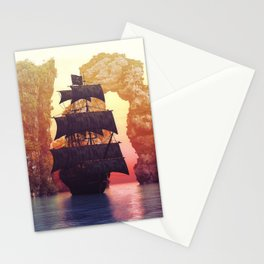 A pirate ship off an island at a sunset Stationery Cards