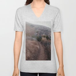 walkway with mountain view and dry grass field Unisex V-Neck