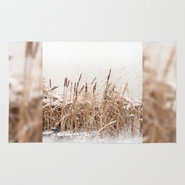 Snow on Typha reeds and frozen water Rug