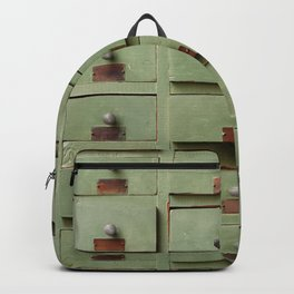 Old wooden cabinet with drawers Backpack