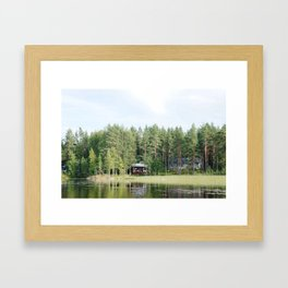 Cabin by the lake in Finland Framed Art Print