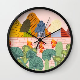 Girl friends watching the sunset over the mountains Wall Clock
