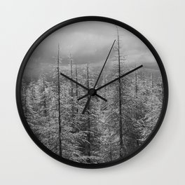 Snowing and sunny. At the same time at the mountains Wall Clock