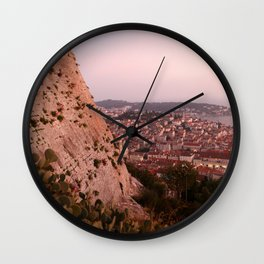 Slit with a golden kiss Wall Clock