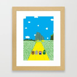 Pengwins that are following a brick road that is yellow Framed Art Print