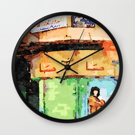 Woman and man sitting on a chair in Aleppo road Wall Clock