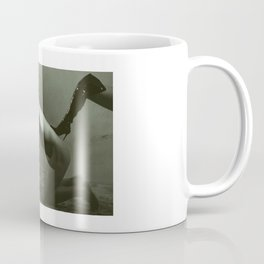Man naked and cuffed in a dungeon Coffee Mug