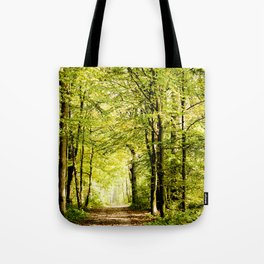A pathway covered by leaves in a magical forest Tote Bag