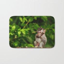 Bali - Baby Monkey Eating Bath Mat