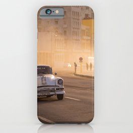 Oldtimer driving over the Malecon in Havana | Cuba travel photography iPhone Case