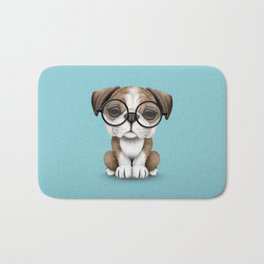 Cute English Bulldog Puppy Wearing Glasses on Blue Bath Mat