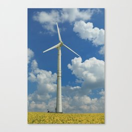 Wind Turbine Windmill in the Landscape with Yellow Colza Field and Blue Sky Canvas Print