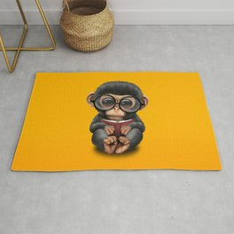 Cute Baby Chimp Reading a Book on Yellow Rug