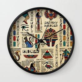 Egyptian hieroglyphs and deities on papyrus Wall Clock