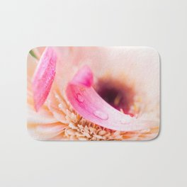 White flower with pink petals Bath Mat