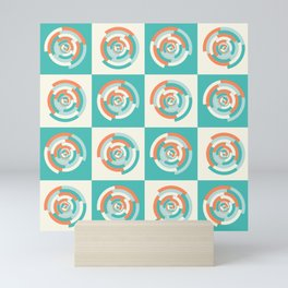 Spinning colourful rings on mint and pale yellow chessboard Mini Art Print