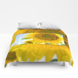 bumblebees taking nectar on yellow sunflower Comforters