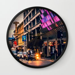 Iconic city street view intersection at sunset time Wall Clock