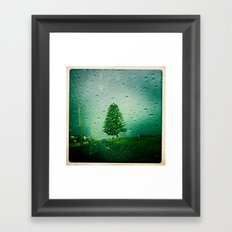 tree in rain Framed Art Print