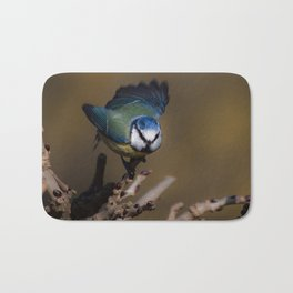 Blue tit about to fly off Bath Mat