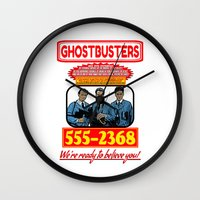ghostbusters Wall Clocks featuring Ghostbusters Advertisement by Silvio Ledbetter