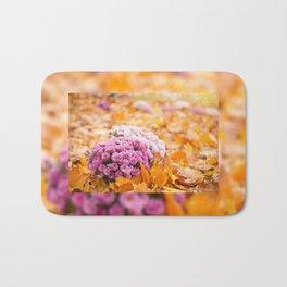 Flowering clump of pink Chrysanths Bath Mat