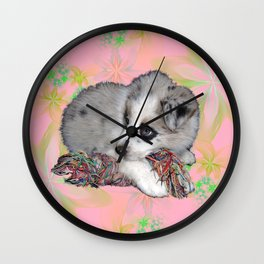 fluffy puppy on flower background Wall Clock