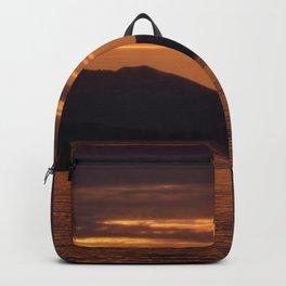 Sunset over the ocean Backpack