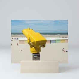 Yellow spotting scope on the beach Mini Art Print