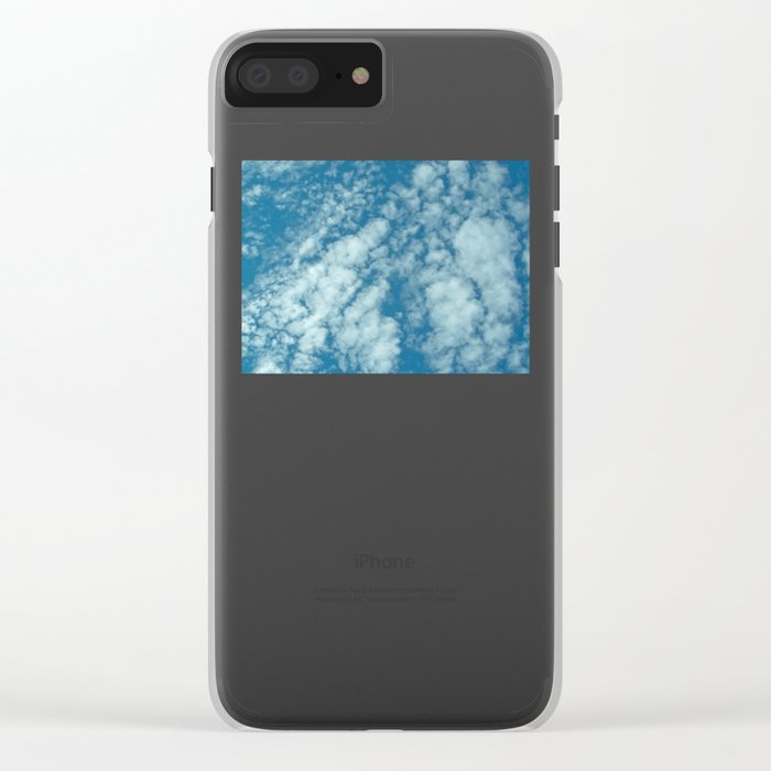 Fluffy clouds in a blue sky Clear iPhone Case
