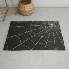 Spiderweb on Black Rug