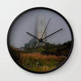 Ghostly Happisburgh church in a sea fret Wall Clock