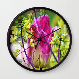 Pink tulip against yellow flowers Wall Clock