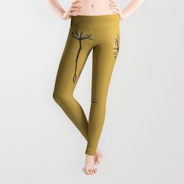 flying dandelion seeds simple seamless pattern on Gold Yellow Background Leggings