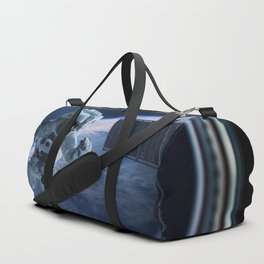 Astronaut in outer space through the porthole Duffle Bag