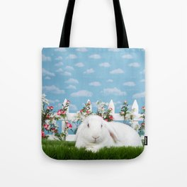 White lop eared bunny in a flower garden Tote Bag